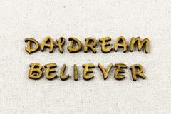 作白日梦信徒相信梦想梦想家活版类型 免版税库存照片