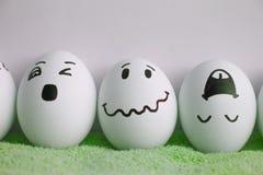 Ägg är gladlynta med en framsida Tre stycken Arkivbilder
