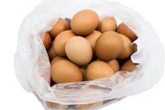 Ägg i en plastpåse. Fotografering för Bildbyråer