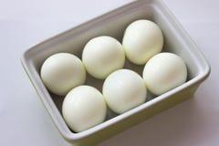 Ägg i grön behållare Royaltyfri Foto