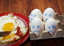 Ägg med den förskräckta framsidan och det stekte ägget Royaltyfria Foton