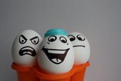 Ägg med en gullig framsida Arkivbild