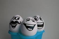 Ägg med en gullig framsida foto Royaltyfria Bilder