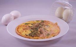 Ägg och omelett Arkivfoto