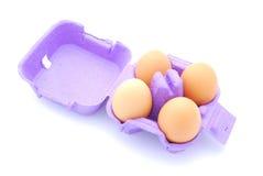 Ägg på vit Arkivfoto