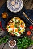 Ägg som tjuvjagas med grönsaker som namnges Royaltyfri Bild