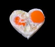 Ägg svart bakgrund för hjärta arkivbild