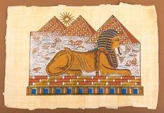 Ägyptische Handpyramiden und -sphinx auf Papyrus lizenzfreie abbildung
