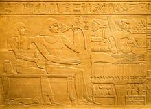 Ägyptische Hieroglyphen geschnitzt auf Lehm Lizenzfreies Stockfoto