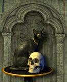 Ägyptische Katze-Statue mit dem Schädel Stockbild