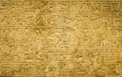 Ägyptischer Hieroglyphenhintergrund Stockfotos