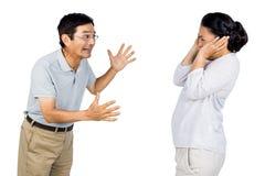 Äldre asiatiska par som har ett argument Royaltyfri Bild