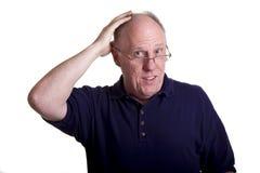 äldre gnidningsskjorta för skallig blå head man Arkivfoto