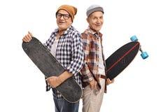 Äldre hipsters med en skateboard och en longboard Royaltyfria Foton