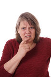 Äldre kvinna som ser förvirrad royaltyfri bild