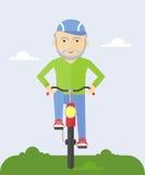 Äldre man på en cykel Royaltyfri Fotografi