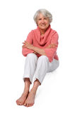 äldre sittande kvinna arkivfoton