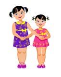 Äldre syster och mer ung syster Arkivfoton