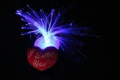 Älska dig hjärta av och de blåa färgstänken av ljus Royaltyfria Bilder