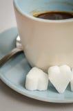 Älska kaffe med socker Arkivbild