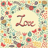 Älska kortet med handskriven förälskelse i blom- ram Arkivbild