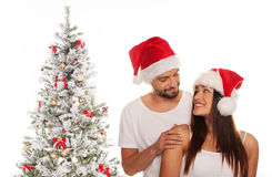 Älska par som firar jul Fotografering för Bildbyråer