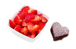 Älskling-format och jordgubbar Arkivfoto