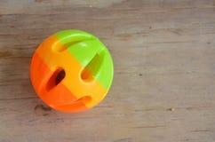 Älsklings- leksakboll för plast- på träbräde Fotografering för Bildbyråer