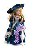 Älskvärd docka i en blå dräkt Fotografering för Bildbyråer