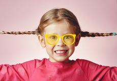 Älskvärd flicka med råttsvansar Royaltyfria Bilder