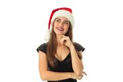 Älskvärd lycklig flicka i den santa hatten Arkivbild