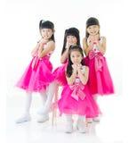 Älskvärda asiatiska flickor arkivfoto