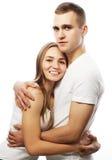 älskvärda lyckliga par som kramar över vit bakgrund Arkivbild