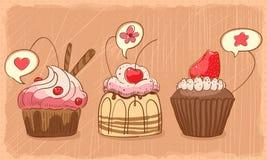 Älskvärda muffiner Arkivbild