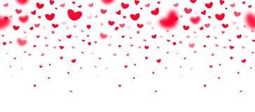 Älskvärda röda fallande hjärtor i fokus och i defocusen på vit bakgrund, en utmärkt ram för hälsningkort, valentin
