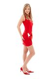 älskvärda röda skor för klänningflickahäl high Arkivfoto
