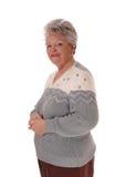 Ältere ältere Frauenstellung Stockfotos