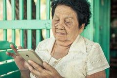Ältere asiatische Frau Stockfotos