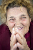 Ältere betende Frau Lizenzfreies Stockfoto