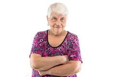 Ältere Dame mit den Armen gekreuzt Lizenzfreies Stockfoto