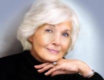 Ältere Dame mit Polostutzen Stockfotografie