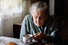Ältere einsame Frau Stockbild