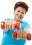 Ältere Frau in der Gymnastik Lizenzfreies Stockfoto