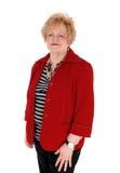 Ältere Frau in der roten Jacke Lizenzfreies Stockbild