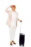 Ältere Frau des Lächelns mit Koffer Lizenzfreie Stockfotos