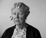 Ältere Frau mit einem Weinlesehut Lizenzfreie Stockfotos