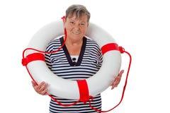 Ältere Frau mit Rettungsgürtel Stockfotografie