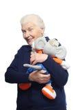 Ältere Frau mit Spielzeug Stockfotos