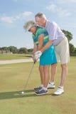 Ältere Golfspieler stockbilder