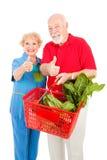 Ältere Käufer geben Daumen auf Stockbild